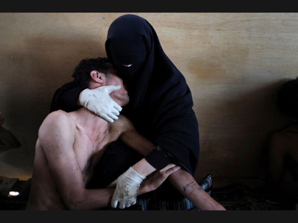 SAMUEL ARANDA, La Pietà islamica, 2011, photo New York Times